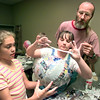 Date:   6/23/98---Lainey Schmidt,9, left, and Laurie Linscomb,10, center get some help from John Hillier as they construct a paper mache' mask during the art class Tuesday afternoon at the Longview Art Museum. kevin green