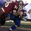 11/21/98---white oak's (35) brings down daignerifield running back (40) in the second half of their playoff game at Lobo Stadium. bahram mark sobhani