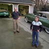 12/29/99---Lee Stewart and his 12 year-old daughter Olivia stand with their two antique Packards. The 1948 car (at right) was restored from 1978-1984, but Stewart is still working on the 1953 (in garage). Olivia was the national secretary for Packard Owners of Tomorrow in 1997-98. bahram mark sobhani