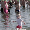 7-18-99  Three year old Hanna Hill takes a stroll thrugh the lake to check out the swimmers prior to thier 1/2 mile swim at the Jefferson Heritage Triathlon at Lake-O-Pines Sandy Beach. Obie LeBlanc