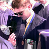 5/8/99---LeTourneau University 99 graduate David Huber, of Waterville Washington, bows with the rest of the 99 graduates for pray duirng the Saturday morning commencement ceremony at LeT in Longview. Kevin green