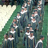 5/29/99--The class of 1999 at Longview High School makes thier way into the colisium duirng graduation ceremonies Saturday afternoon at LHS campus in Longview. Kevin green