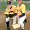 5/12/99---Ben, left, and dad Elliot Johnson, right, kneel on home plate as they look through a Bible on the LeTourneau baseball field Wednesday afternoon in Longview. Kevin green