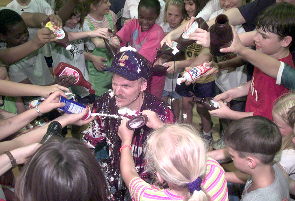 5/21/99---Leverett's Chapel elementary principal Brian Weaver, center, waits as students make him a human sundae for a challange he made with the fourth, fifth, and sixeth graders to reach 3500 points on the excelerated reader program Friday afternoon at Leverett's Chapel. Kevin green