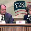 10-20-99---SWEPCO representative Keith Honey, left, listens while Southwestern Bell's Anita Meyer, right, anwers questions during a Y2K infromation call-in Wednesday night at city hall in Longview. Kevin GReen