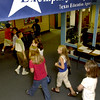 Pine Tree middle 5/6 students head back to class while a banner hangs near the office stating the schools exemplary status Thursday August 16, 2001 in Longview. Kevin Green