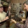 Greg Winchester, left, shows Steve Tehan, right, of Longview, a few shotguns at a local sporting goods store Thursday August 30, 2001 in Longview. Kevin Green
