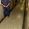 Ronnie Weaver stands on Granite floors in the hallways of the fourth floor that  he intends to renovate into apartments at the Cargill building which he and his wife Tanya have recently purchased Wednesday August 29, 2001 in downtown Longview. Kevin green