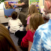 Sprig Hill Primary school teacher Kathy Cole reads a book to her kindergarten class Thursday August 16, 2001 in Longview. Cole moved to the primary school after teaching at the high school last school year. Kevin green