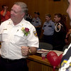 Retiring Longview Fire Department assistant fire chief Bill Parrymore visits with well wishers at his retirement party at Longview City Hall Friday 17, 2001 in Longview. Kevin green