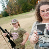 Brenna East,12, holds her 7mm.08 as her mom Lisa East holds a photo of Brenna with her deer she shot Thursday, Nov. 21, 2013, at their home in Harmony.  (Kevin Green/News-Journal Photo)