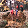 Keith Kupiec, left, and Eddie Hernadez, right, with Public Works of the City of Longview try to find a culvert under Gregg Tex Road, Wednesday afternoon after the road collapsed due to excessive water flow. Kevin green