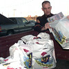 12-21-99---U.S. Marines SGT. Dale Graham loads Toys for Tots left-over presents into a vehicle Tuesday afternoon at the Longview Fairgrounds in Longview. Kevin Green