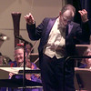 """12/30/99---Conductor Tonu Kalam beckons the audience to join in with clapping during the final piece of the Longview Symphony Orchestra's """"A Night in Old Vienna"""" Thursday night."""
