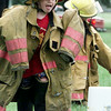 5/18/99---Bradon Oram, 5, negotiates a turn around a bucket in a race wearing full firefighter gear Tuesday at McWhorter Park. Longview Fire Department members hosted games and a weinie roast for the Greggton UMC New Horizons Preschool class. bahram mark sobhani