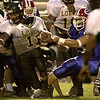 Longview High School's #11 Willie Andrews, left, trys to break free from Evangel Christian Academy's # 13 Jacob Hester, right, duirng a game Friday August 31, 2001 in Shreveport. Kevin green