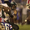 LONGVIEW HIGH SCHOOL'S JOEL ARMSTRONG GETS TACKLED BY EVANGEL PLAYERS DURING FRIDAY NIGHT'S GAME IN SHREVEPORT. KEVIN GREEN