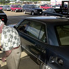 GL Brelsford, of Longview, returns the pump nossle after filling up with gas with long lines Tuesday September 11, 2001 at Sam's Wholesale Club in Longview. Kevin green
