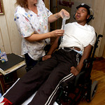 Karen Lair, left, nurse for Jonathan Pierce Lawson, 14, right, is feed through a tube at his home in Longview, Tuesday Jnue 24, 2003 in Longview. Kevin Green